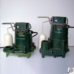 Two cast-iron Zoeller sump pump systems.